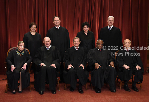 Members of the US Supreme Court pose for a group photograph at the Supreme Court building on June 1 2017 in Washington, DC. Front row. Seated from left, Associate Justice Ruth Bader Ginsburg, Associate Justice Anthony M. Kennedy, Chief Justice of the United States John G. Roberts, Associate Justice Clarence Thomas, and Associate Justice Stephen Breyer and Standing behind from left, Associate Justice Elena Kagan, Associate Justice Samuel Alito Jr., Associate Justice Sonia Sotomayor, and Associate Justice Neil Gorsuch.<br /> Credit: Olivier Douliery / Pool via CNP