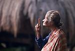 The elderly bard of Luba Village, near Bajawa, Flores, greets visitors with a prophecy.