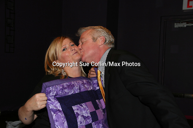 Wendy Madore presents Jerry verDorn with a gift at the 2009 Daytime Stars and Strikes to benefit the American Cancer Society to benefit the American Cancer Society on October 11, 2009 at the Port Authority Leisure Lanes, New York City, New York. (Photo by Sue Coflin/Max Photos)