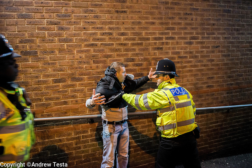 UK. Northampton. 7th December 2013<br /> Police move in to break up a fight in a Northampton backstreet.<br /> &copy;Andrew Testa for the New York Times
