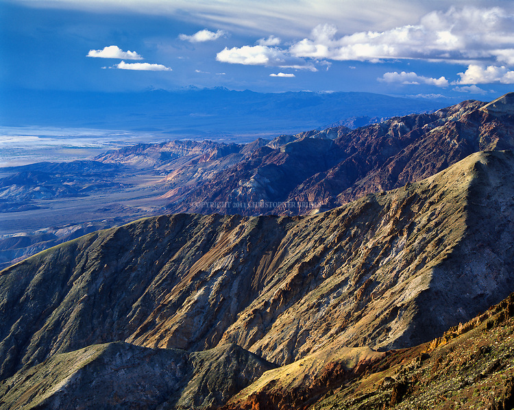 View of the valley looking north from Dante's View (5,500 feet (1,700 m) above sea level). Black Mountains foreground, Funeral Mountains in background. Death Valley National Monument Est. February 11, 1933; Death Valley National Park in 1994. 5,270 square miles (13,649 km2). Inyo County, CA.