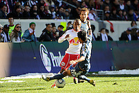 A.J. DeLaGarza (20) of the Los Angeles Galaxy tackles the ball from Dane Richards (19) of the New York Red Bulls during the 1st leg of the Major League Soccer (MLS) Western Conference Semifinals at Red Bull Arena in Harrison, NJ, on October 30, 2011.
