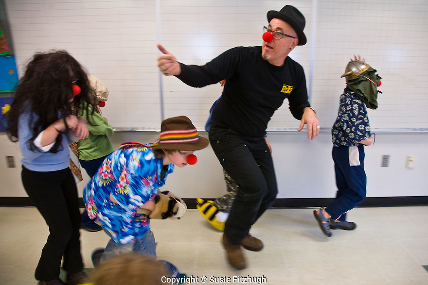 David Crellin, co-founder of Circus Contraption and a multitalented performance artist, teaches elementary schoolchildren the art of being a clown.