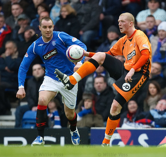 Garry Kenneth clears from Kris Boyd