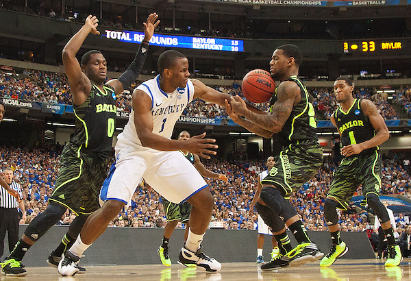 UK guard Darius Miller battles for a loose ball with Baylor Bears guard Gary Franklin, left, and Baylor Bears guard Deuce Bello. Kentucky faced Baylor during the 2012 NCAA Tournament Regional Finals at the Georgia Dome in Atlanta, March 25, 2012. Photo by Derek Poore