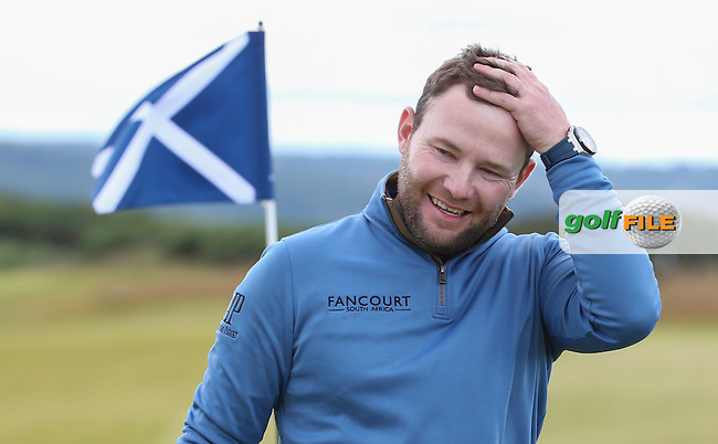 Branden Grace (RSA) smiling as he completes a T2 round, during Round Two of the 2016 Aberdeen Asset Management Scottish Open, played at Castle Stuart Golf Club, Inverness, Scotland. 08/07/2016. Picture: David Lloyd | Golffile.<br /> <br /> All photos usage must carry mandatory copyright credit (&copy; Golffile | David Lloyd)