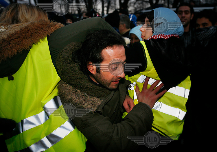 A protester tries to breach security  line. Pro-Palestinian protesters clashed with police as they held another demonstration against Israel in the Norwegian capital Oslo. Violent clashes lasted for hours  in the centre of Oslo. Israeli forces began a series of air strikes on the Gaza Strip on the 27th of December in retaliation against Hamas rockets fired into Israel. After eight days of bombardment, leaving over 400 Palestinians and four Israelis dead, Israeli tanks launched a ground invasion on the 4th of January.