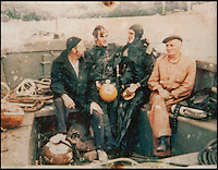 BNPS.co.uk (01202 558833)<br /> Pic: PhilYeomans/BNPS<br /> <br /> Ray Ives Locker<br /> <br /> Ray (3rd left) diving on the wreck of a Canberra bomber in Lyme Bay in 1967.<br /> <br /> Old man of the sea Ray Ives has opened his very own Davy Jones' locker of hundreds of nautical treasures he has salvaged from the seabed.<br /> <br /> Ray(77) has spent 40 years amassing a huge trove of historical artefacts that he has found during thousands of deep sea dives off the British coast.<br /> <br /> Ray's watery Aladdins cave includes canon balls, muskets, swords and even the bell from an ocean liner sunk by a German U-boat in the First World War.<br /> <br /> For years Ray had stuffed his collection into a tiny shed in the back garden of his home in Plymouth, Devon.<br /> <br /> But now the fascinating archive has now gone on display to the public in a ramshackle museum made from shipping containers.
