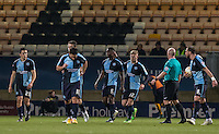 Jason McCarthy (22) of Wycombe Wanderers consoles Anthony Stewart (5) of Wycombe Wanderers who appeared to make contact after Josh Coulson of Cambridge United for the goal during the Sky Bet League 2 match between Cambridge United and Wycombe Wanderers at the R Costings Abbey Stadium, Cambridge, England on 1 March 2016. Photo by Andy Rowland / PRiME Media Images.