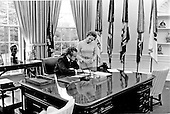 United States President Richard M. Nixon at work in the Oval Office of the White House with his secretary, Rose Mary Woods in Washington, D.C. on February 2, 1973.<br /> Credit: White House via CNP