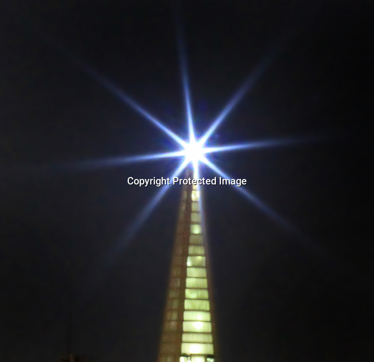 The holiday beacon on the Transamerican Pyramid lights up during the holiday season.