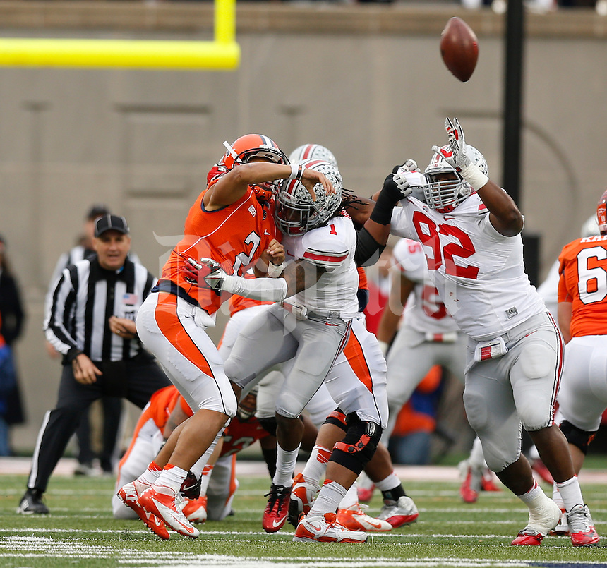 Illinois Fighting Illini quarterback Nathan Scheelhaase (2) throws the ball as he is tackled by Ohio State Buckeyes cornerback Bradley Roby (1) during the second half of Saturday's NCAA Division I football game at Memorial Stadium in Champaign, Il., on November 16, 2013. Ohio State won the game 60-35. (Barbara J. Perenic/The Columbus Dispatch)