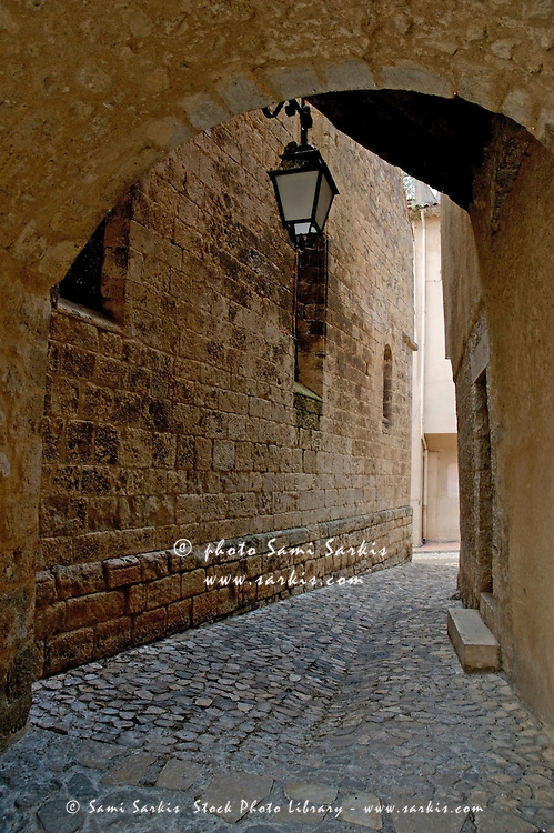 Quaint, cobbled alleyway in Moustiers-Sainte-Marie, Provence, France.