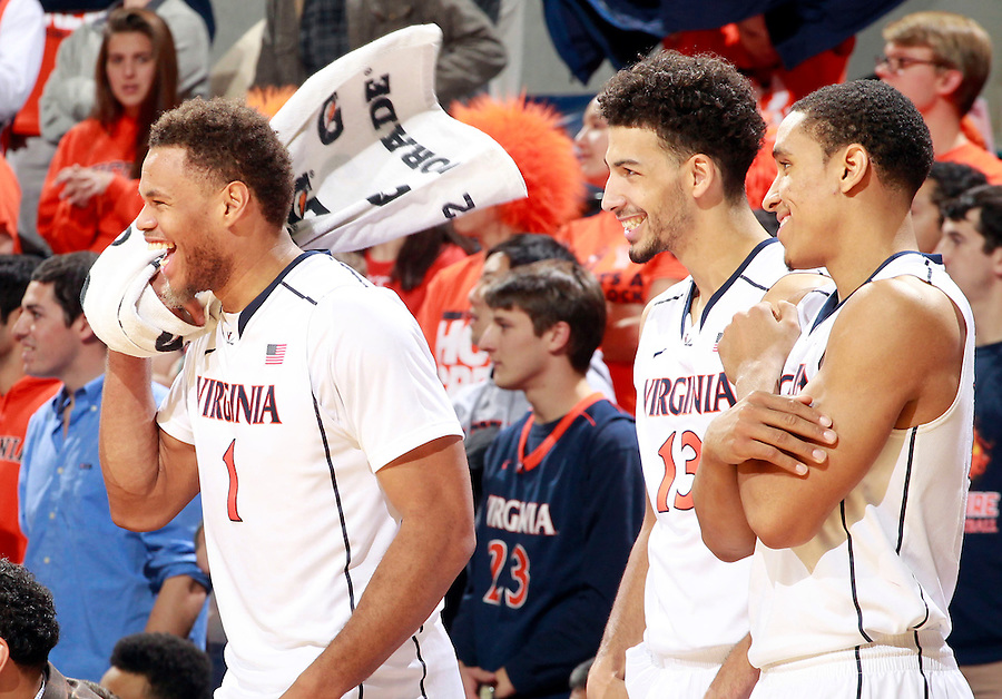 Virginia guard Justin Anderson (1) reacts with teammates Anthony Gill (13) and Malcolm Brogdon (15) during an ACC basketball game Jan. 13, 2015 in Charlottesville, VA Virginia won 65-42.
