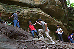 My husband, helps our older son, age seven, climb up a canyon wall during a family vacation to Starved Rock State Park in Oglesby, Ill.