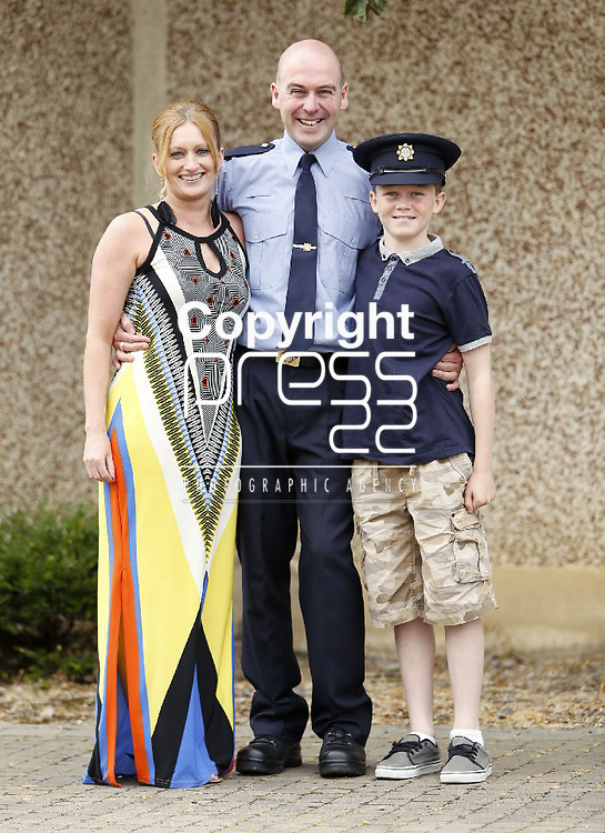15/07/2013 Reserve Garda Graduate Conor Brady from Blanchardstown pictured with son Aaron and Jean Hart at a Garda Reserve Graduation Ceremony which took place at the Garda Training College, Templemore, Co. Tipperary. Picture: Don Moloney / Press 22
