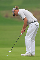 Marcel Siem (GER) putts on the 17th green during Saturay's Round 3 of the 2014 BMW Masters held at Lake Malaren, Shanghai, China. 1st November 2014.<br /> Picture: Eoin Clarke www.golffile.ie