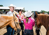 Miss Rodeo Colorado 2016 contestants from left, Kellie Stockton, Sara Coblentz, and Tess Mahoney during the horsemanship competition at the Miss Rodeo Queen Colorado competition at the Greely Stampede in Greely, Colorado, July 1, 2015.<br /> <br /> Photo by Matt Nager