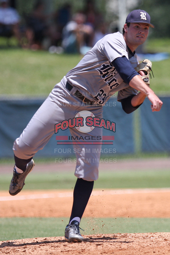Starting pitcher Kevin McCanna (23) of the Rice University Owls makes a pick-off throw to first base against the Florida Atlantic Owlsat FAU Baseball Stadium on May 9, 2015 in Boca Raton, Florida.  The Rice Owls defeated the FAU Owls 5-1.  (Stacy Jo Grant/Four Seam Images)