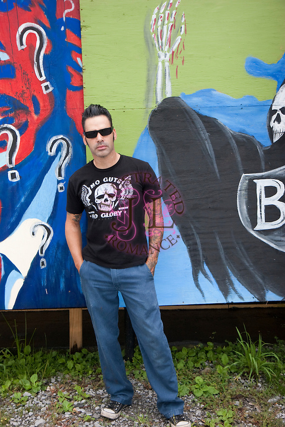 Tattoo shop owner and artist Bobby Pitre decided to let his opinion be known with artwork painted by he and a friend on the side of his Larose tattoo parlor. He said he could stand on the corner and yell about it, or he could paint this and let it speak for him 24 hours a day, seven days a week. His parlor Southern Sting, sits on a prominent corner on the main highway between New Orleans and Grand Isle, La. <br /> Photo by: Jenn LeBlanc/Iris Photo Agency
