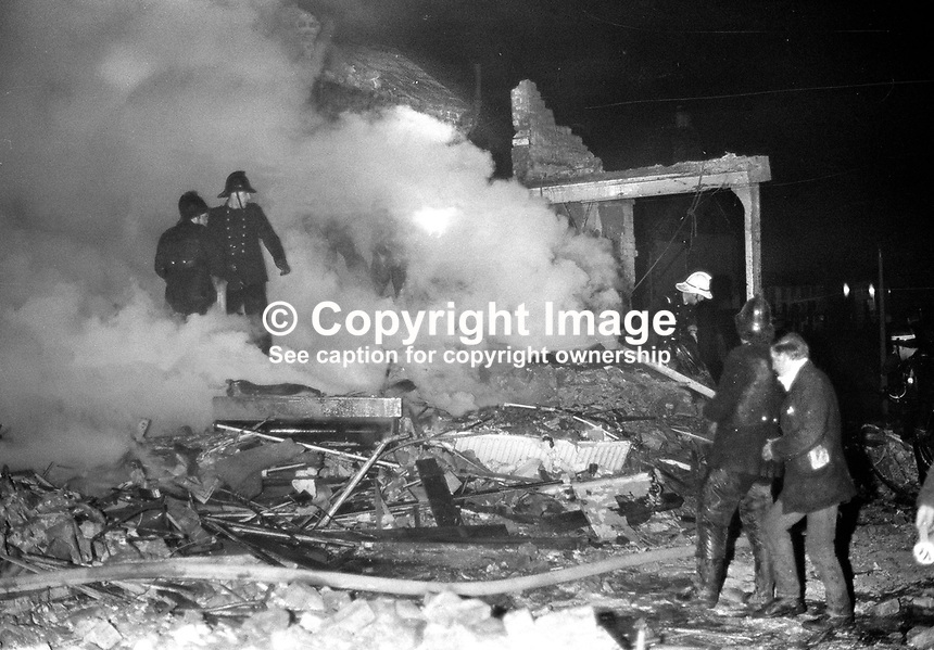 McGurk's Bar explosion in which 15 people died. Among those who died were the bar owner's wife and daughter. Thirteen were injured, one of whom subsequently died. Firemen in the smoking remains of the bar. NI Troubles. Ref: 19711204001...Copyright Image from Victor Patterson, 54 Dorchester Park, Belfast, UK, BT9 6RJ..Tel: +44 28 9066 1296.Mob: +44 7802 353836.Voicemail +44 20 8816 7153.Skype: victorpattersonbelfast.Email: victorpatterson@mac.com.Email: victorpatterson@ireland.com (back-up)..IMPORTANT: If you wish to use this image or any other of my images please go to www.victorpatterson.com and click on the Terms & Conditions. Then contact me by email or phone with the reference number(s) of the image(s) concerned.