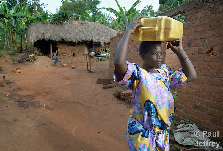 Annett Nakamya carries water from a well to her house in Kabulasoke, Uganda, where the Ntulume Village Women Development Association has trained women in improved agricultural practices, thus increasing food security and empowering women and children. The project was supported by funding from the Call to Prayer and Self-Denial of United Methodist Women.