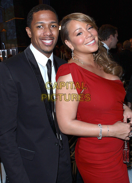 NICK CANNON & MARIAH CAREY.16th Annual Screen Actors Guild Awards  held  at the Shrine Los Angeles, Los Angeles, CA, USA, .23rd January 2010..SAG SAGs half length red one shoulder dress black suit tie married husband wife couple smiling silver diamond bracelets earrings dangly handbag bag .CAP/ADM/TC.©T.Conrad/Admedia/Capital Pictures
