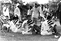 Members of the Nueva Esperanza football team resting during half-time break in local match. Community of Nueva Esperanza, El Salvador, 1999.