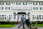PALCO gardener Jack Saffell mows the yard of the Scotia Inn, and the rest of the town, on Wednesday, June 28, 2006. The town of Scotia in Northern California is a company town owned by the Pacific Lumber Company (PALCO), but that will change as the company will begin to sell the town. (Photo by Max Whittaker for The New York Times)<br />
