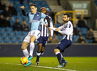 Stephen McGinn of Wycombe Wanderers and David Worrall of Millwall during the Checkatrade Trophy round two Southern Section match between Millwall and Wycombe Wanderers at The Den, London, England on the 7th December 2016. Photo by Liam McAvoy.