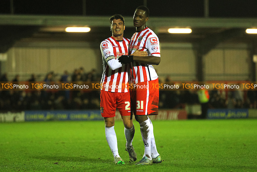 Ron Henry (L) and Armand Gnanduillet of Stevenage celebrate victory after the game during AFC Wimbledon vs Stevenage, Sky Bet League 2 Football at the Cherry Red Records Stadium, Kingston, England on 12/12/2015