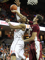 Virginia forward Akil Mitchell (25) is fouled by Florida State center Boris Bojanovsky (15) during the second half of an NCAA basketball game Saturday Jan. 18, 2014 in Charlottesville, VA. Virginia defeated Florida State 78-66. (AP Photo/Andrew Shurtleff)