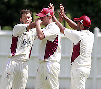 Connor Nurse (L) of North Middlesex is congratulated after taking a Brondesbury wicket during the ECB Middlesex Premier League game between North Middlesex and Brondesbury at Park Road, Crouch End on Sat June 21, 2014.
