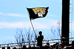 06 November 2016: A Wake Forest fan flies a flag above the stadium. The Wake Forest University Demon Deacons hosted the University of Notre Dame Fighting Irish at Spry Stadium in Winston-Salem, North Carolina in a 2016 NCAA Division I Men's Soccer match and an Atlantic Coast Conference Men's Soccer Tournament quarterfinal. Wake Forest won the game 1-0.