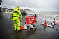 Pictured: A police officer makes sure that the seaside road is closed off because of waves that crash against the seaside town of Aberystwyth, Wales, UK. Saturday 21 October 2017<br /> Re: Coastal parts of the UK is facing winds of up to 70mph as Storm Brian causes roads to close and public transport to be cancelled.<br /> Roads in Aberystwyth's seafront and at nearby Aberaeron, Wales are shut on Saturday morning as a yellow &quot;be aware&quot; Met Office warning is in place.<br /> Seven flood warnings have been issued for the west Wales coast.