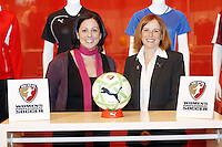 WPS Commissioner Tonya Antonucci unveils the league soccer ball with Tara McRae, Director of Sports Marketing for Puma in St. Louis, Thursday, Jan. 15, 2008/.