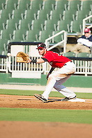 Kannapolis Intimidators first baseman Danny Hayes (32) stretches for a throw during the game against the Augusta GreenJackets at CMC-NorthEast Stadium on August 3, 2014 in Kannapolis, North Carolina.  The Intimidators defeated the GreenJackets 10-5. (Brian Westerholt/Four Seam Images)