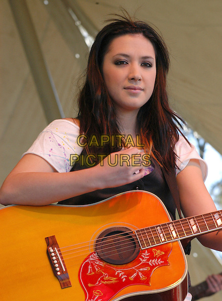 "THE WRECKERS - MICHELLE BRANCH.Bring their ""Stand Still, Look Pretty"" tour to the VB Bike Classic, Virginia Beach, Virginia, USA..April 21st, 2007.half length stage concert live gig performance music guitar .CAP/ADM/MK.©Mike Kline/AdMedia/Capital Pictures"