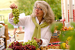 Mature woman holding grapes