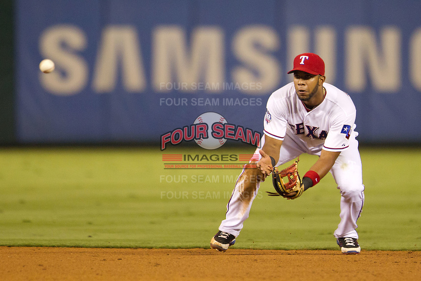 Texas Rangers shortstop Elvis Andrus #1 fields a grounder during the Major League Baseball game against the Baltimore Orioles on August 21st, 2012 at the Rangers Ballpark in Arlington, Texas. The Orioles defeated the Rangers 5-3. (Andrew Woolley/Four Seam Images)