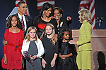 (Clockwise from top left) U.S. President Elect Barack Obama, his wife Michelle Obama, her mother Marion Robinson, Jill Biden, the wife of Vice-President Elect Joseph Biden, Malia Obama, the youngest daughter of Barack and Michelle, two of Jill and Joseph Biden's grandchildren, and the eldest daughter Malia Obama join the Obamas on stage after Barack Obama's victory speech upon being named the 44th U.S. President in Grant Park in Chicago, Illinois on November 4, 2008.
