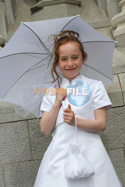 Louise Riordan at the Scoil Aonghusa Communion 2011...(Photo credit should read Jenny Matthews www.newsfile.ie)....This Picture has been sent you under the conditions enclosed by:.Newsfile Ltd..The Studio,.Millmount Abbey,.Drogheda,.Co Meath..Ireland..Tel: +353(0)41-9871240.Fax: +353(0)41-9871260.GSM: +353(0)86-2500958.email: pictures@newsfile.ie.www.newsfile.ie.