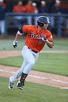 David Olmedo-Barrera (23) of the Cal State Fullerton Titans runs to first base during a game against the Cal Poly Mustangs at Goodwin Field on April 2, 2015 in Fullerton, California. Cal Poly defeated Cal State Fullerton, 5-0. (Larry Goren/Four Seam Images)