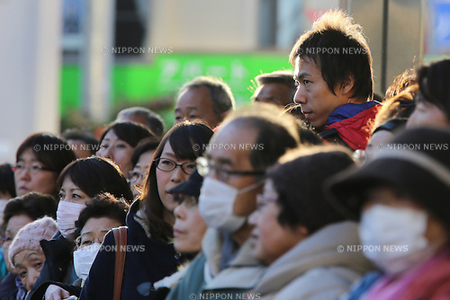 Voters listen to Japan's ruling Liberal Democratic Party (LDP) lawmaker  Shinjiro Koizumi delivering a speech atop a campaign car to support  a candidate in Kawasaki city, Japan, on Saturday, December 13, 2014.  (Photo by Yuriko Nakao/AFLO)