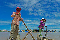 Life on and around the Tonle Sap Lake Cambodia Traditional Khmer Women rowing, paddling on the Tonle Sap,