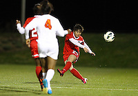 BOYDS, MARYLAND - April 06, 2013:  Diana Weigel (24) of The Washington Spirit sends a long pass up field against the University of Virginia women's soccer team in a NWSL (National Women's Soccer League) pre season exhibition game at Maryland Soccerplex in Boyds, Maryland on April 06. Virginia won 6-3.