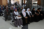 Families of Palestinian martyrs wait at the Rafah border crossing between Egypt and the southern Gaza Strip, on September 17, 2015, as they head to the annual hajj pilgrimage in Saudi Arabia's holy city of Mecca. Custodian of the Two Holy Mosques King Salman has issued orders to host 1,000 Palestinians from martyrs' families to perform Haj this year. According to the Muslims holy book the Koran, the Kaaba was built by Abraham and his son Ismael, after Ismael had settled in Arabia. Millions of Muslims have arrived in Saudi Arabia to perform their Haj. Photo by Abed Rahim Khatib