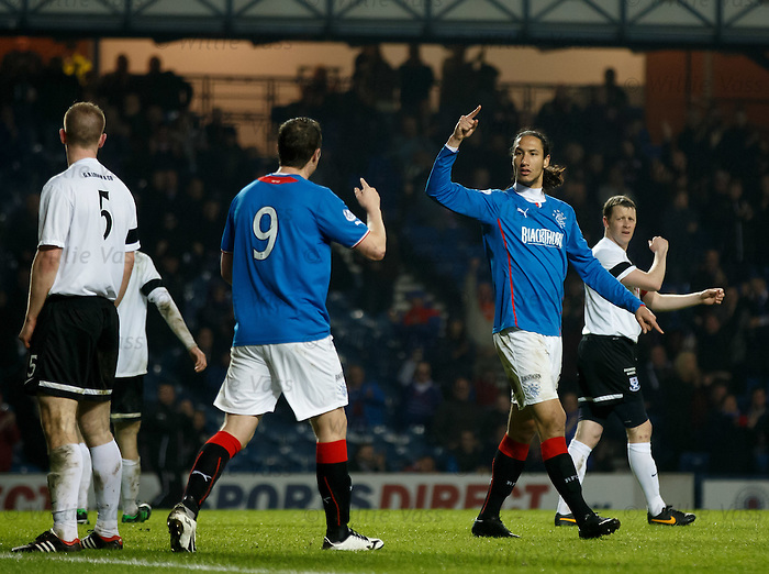 Bilel Mohsni celebrates after opening the scoring for Rangers