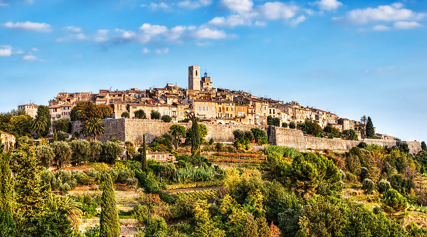 A view of Saint-Paul-de-Vence from the Route de la Colle in the reddish light of a late afternoon sun.