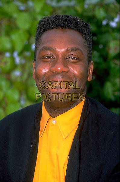 LENNY HENRY .Ref: 3146.pre 2001.headshot portrait yellow black blue.CAP/RB.©RB/Capital Pictures.